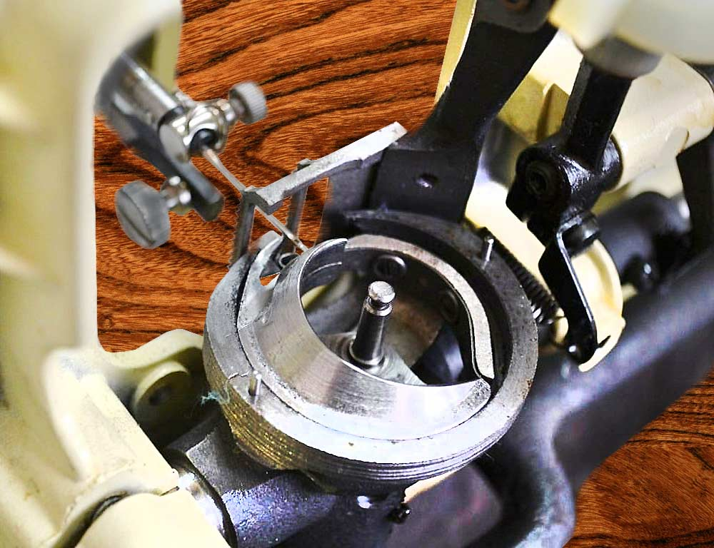 чистка-челнока швейной машины